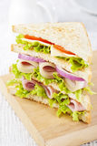 Club sandwich. With ham and vegetables royalty free stock photography