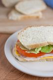 Club Sandwich. On homemade white bread on a counter top Royalty Free Stock Images