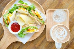 Club sandwich with hot mocha. On the table Royalty Free Stock Images