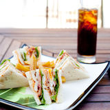 Club sandwich with iced soda drink Stock Image