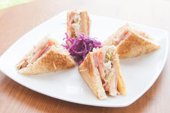 Club sandwich made with turkey, bacon, ham, tomato, cheese, lettuce Stock Images