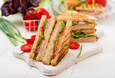 Club sandwich - panini with ham, cheese, tomato. And herbs. Top view Stock Photography