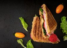 Club sandwich panini with ham, tomato, cheese Royalty Free Stock Photography