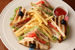 Club sandwich with potato French fries Royalty Free Stock Images