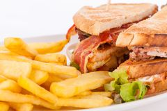 Club sandwich with potato French fries Stock Images