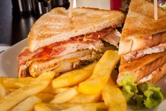 Club sandwich with potato French fries Stock Photography
