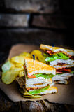 Club sandwich on rustic wooden background Stock Images