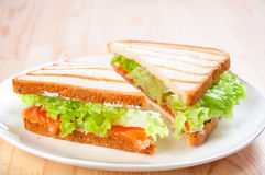 Club sandwich with salmon, cheese, lettuce Stock Image
