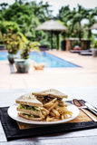 Club sandwich snack with french fries on plate Royalty Free Stock Photos