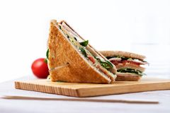 Club sandwich, with tomato, lettuce and cheese on white background stock image