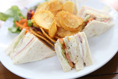Club sandwich with on wood background Stock Image
