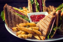 Club sandwiches and french fries Royalty Free Stock Images