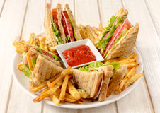 Club sandwiches and french fries Royalty Free Stock Image
