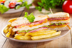 Club sandwiches with french fries Royalty Free Stock Images