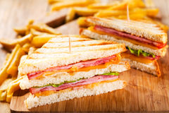 Club sandwiches with french fries Stock Photography