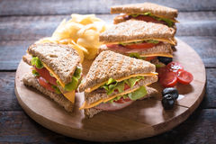 Club Sandwiches. Group of club sandwiches with potato chips on wooden bacground,selective focus Royalty Free Stock Photos