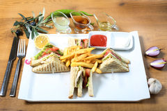 Club sandwiches potato fries. Club sandwiches with potatoe fries and sause, onion Royalty Free Stock Photography