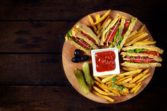 Club sandwiches on the wooden table Stock Photography