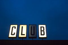 Club sign. And deep blue background with plenty of room for text or add your own letters in place of club Stock Photography