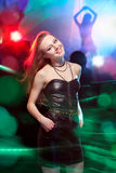Clubber dancing and looking at camera with smile Royalty Free Stock Photo