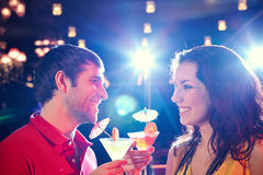 Clubbing couple with drinks Stock Images