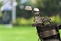 Clubes de golfe diferentes no fundo Foto de Stock Royalty Free