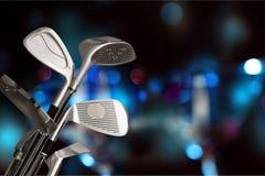 Clubes de golfe diferentes no fundo Fotos de Stock