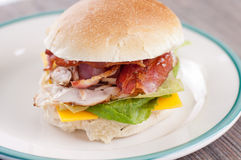Clubhouse sandwich on a burger bun Royalty Free Stock Image