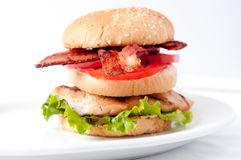 Clubhouse sandwich on a burger bun Royalty Free Stock Photography