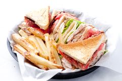 Clubhouse sandwich with crispy fries Royalty Free Stock Image