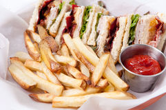 Clubhouse sandwich with fries Stock Photography