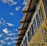 Clubhouse windows blue sky background. Clubhouse windows against a blue cloudy background Stock Photography
