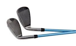 Clubs de golf sur le blanc Photos stock