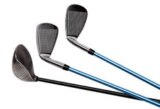Clubs de golf sur le blanc Images stock
