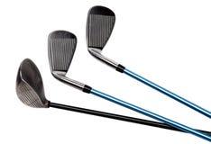 Clubs de golf sur le blanc Images stock