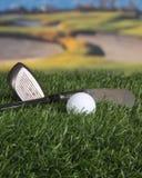 Clubs de golf y bola Fotografía de archivo