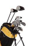 Clubs de golf y bolso en blanco imagen de archivo