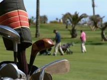 Clubs de golf y campo de golf Foto de archivo libre de regalías