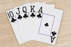 Clubs de la escalera real - casino que juega tarjetas del póker imagenes de archivo