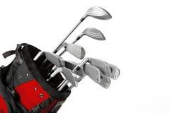 Clubs des professionellen Golfs in einem ledernen Gepäck bei Sonnenuntergang lizenzfreie abbildung