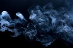 The blue clubs smoke on a black background. The clubs smoke on a black background, horizontal. Fluid effect Royalty Free Stock Photos