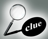 Clue word mystery concept with magnifying glass Stock Photography