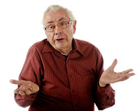 Clueless!. An senior man shrugging his shoulders with an obvious clueless expression Royalty Free Stock Image