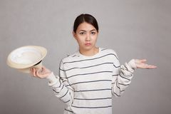 Clueless Asian girl with a  hat Stock Photos
