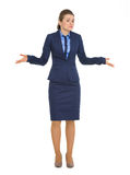 Clueless business woman shrugging shoulders Stock Photography