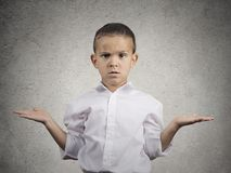 Clueless child boy with arms out asking what's problem. Closeup portrait clueless, unhappy child boy with arms out asking what's problem who cares, so what, I Royalty Free Stock Photos