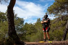 Clueless diver in the forest stock photography
