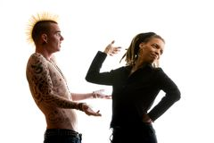 Clueless Man and Reacting Woman. Man with Mohawk and Woman wearing Dreadlocks Royalty Free Stock Images