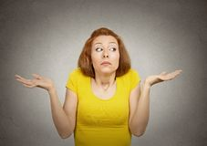 Clueless woman with arms out shrugs shoulders Royalty Free Stock Photo