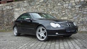 Cluj Napoca/Ρουμανία 7 Απριλίου 2017: Benz W209 Coupe της Mercedes - έτος 2005, εξοπλισμός κομψότητας, ρόδες 19 ιντσών, άποψη σχε Στοκ Φωτογραφία